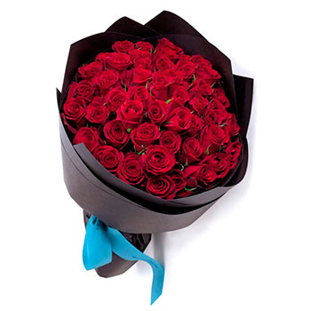 Bouquet of red roses  in kraft paper