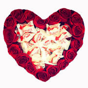Heart of red roses and candies